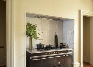 A compact Le Creuset kitchen.