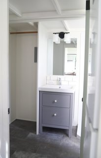 The bathroom includes hookups for a washer/dryer unit, as well as additional storage nooks.