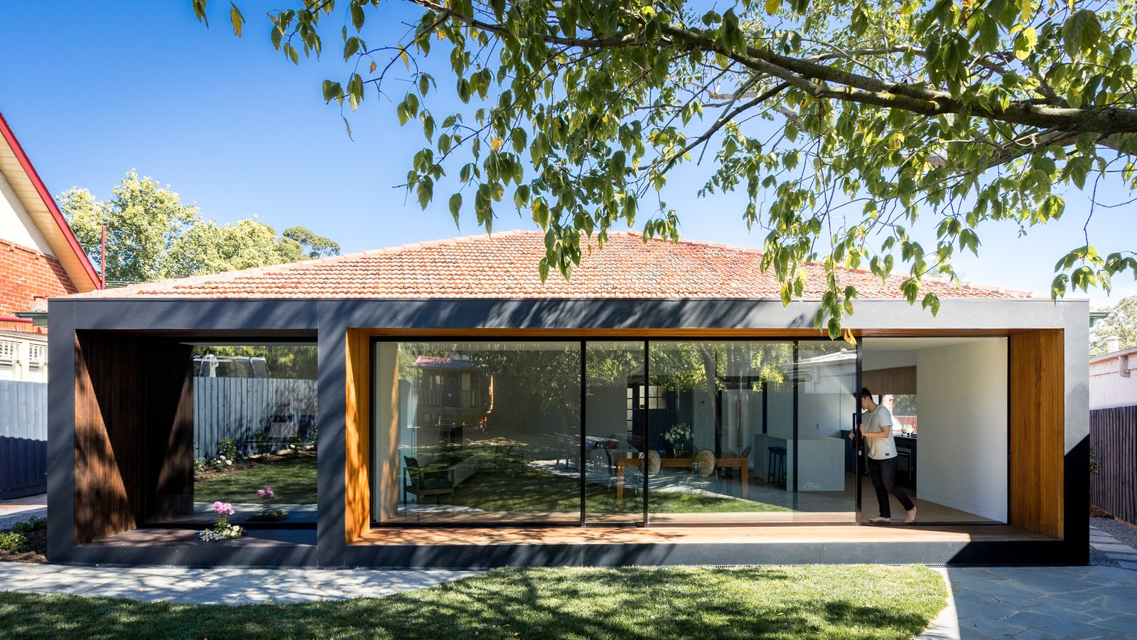 Outdoor, Back Yard, Small Patio, Porch, Deck, and Grass To make the home look and feel larger, the MODO team ironically made the new house smaller in size.    Photo 4 of 9 in A Melbourne Home Decreases in Size to Amp Up Its Outdoor Connection