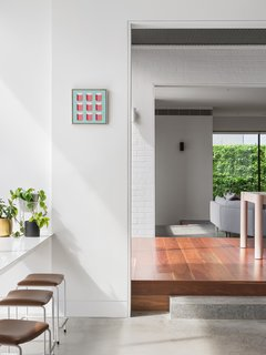 White walls and fit-outs give the home a light, summery atmosphere.
