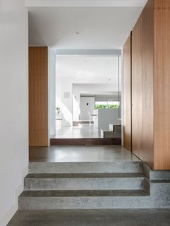 Internal brick walls and polished concrete surfaces provide thermal mass that help keep the interior spaces cool.