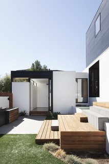 On the ground floor, the house comprises a series of brick volumes.