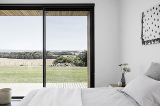Each room frames a picturesque view of the rural landscape.