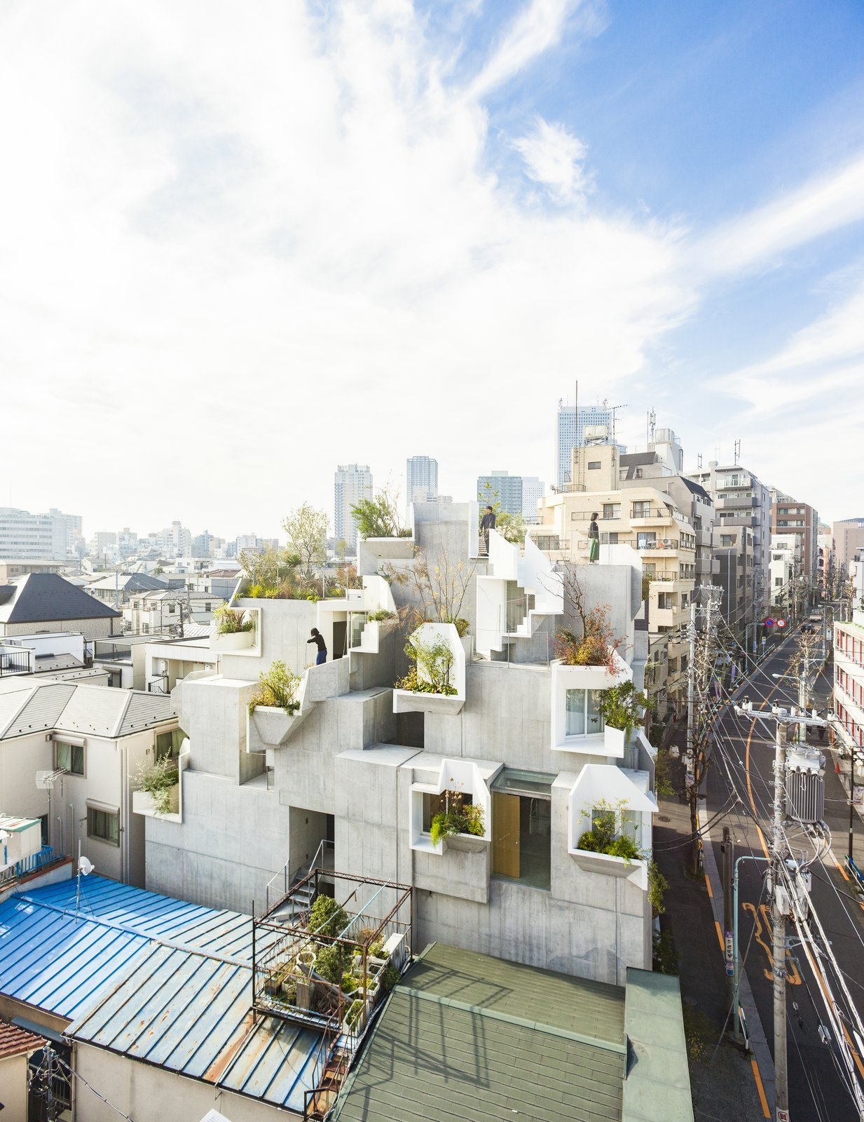 Exterior, Concrete Siding Material, and Apartment Building Type  Best Photos from This Futuristic Japanese Building Is Not Your Everyday Tree House