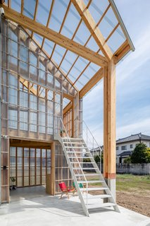 The greenhouse structure is clad entirely in translucent acrylic glass.
