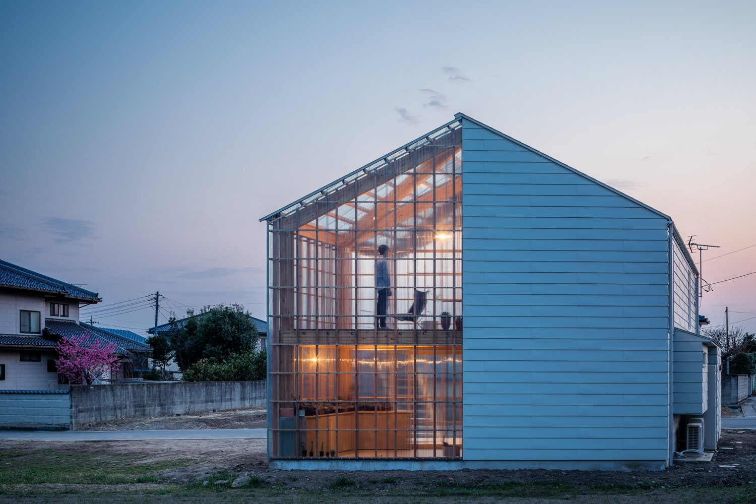 Exterior, Wood Siding Material, House Building Type, Glass Siding Material, Gable RoofLine, and Metal Roof Material  Photos from This Dreamy Japanese Abode Is Part Greenhouse