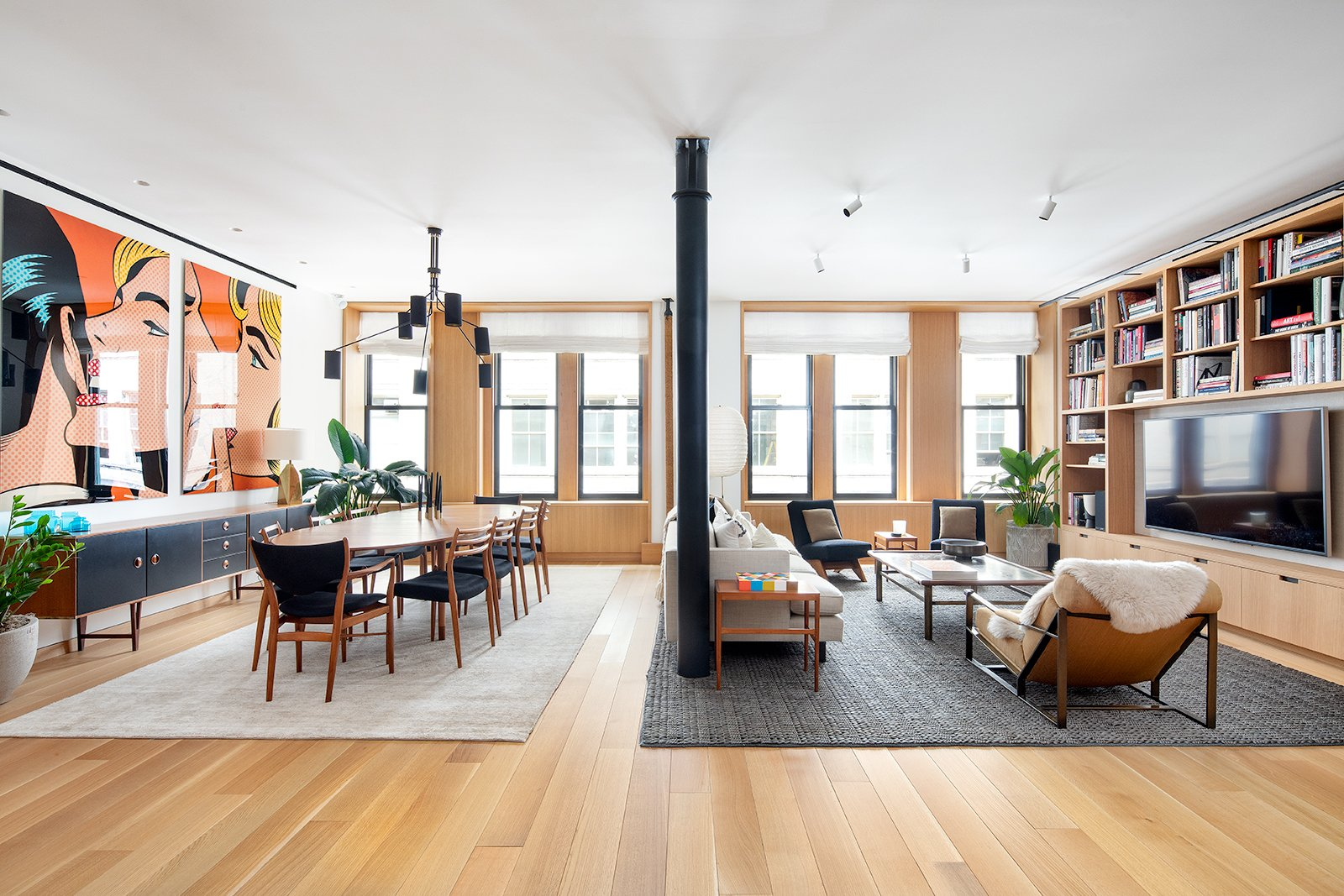 Living Room, Chair, Sofa, Light Hardwood Floor, End Tables, Recessed Lighting, Coffee Tables, Rug Floor, Ceiling Lighting, Shelves, Floor Lighting, Pendant Lighting, and Console Tables  Photos from An Updated Historic Loft in Manhattan Is Listed For $4.5M