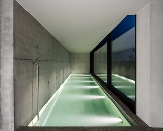 The indoor swimming pool now features a tall wall of glass.