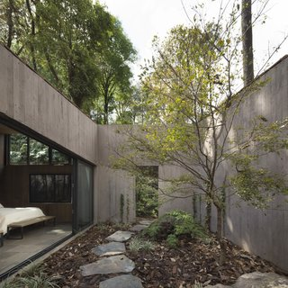 """""""The patios at the ends of the house are left open to the landscape, and evoke the feeling of ruins,"""" says Derek Dellekamp, the founder of the studio."""
