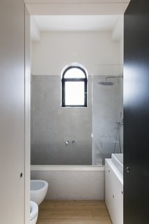 Dotted mosaic tiles by Fornace Brioni have also been used for the daughter's bathroom.