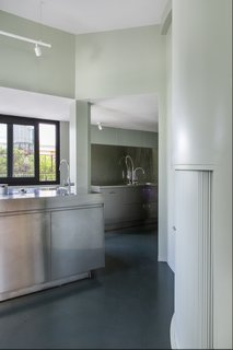 The kitchen has also been given a modern upgrade, now featuring stainless steel appliances.