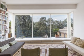 Expansive windows have been installed to flood the house with sunlight and capture sweeping views of the park outside.