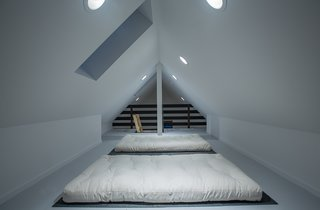 The clean, white interiors also follow the Danish sommerhus' simplicity of form and color.