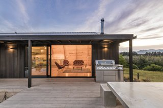The low-mass structure enables the house to warm up quickly in winter, and the geometric, concrete mass that wraps around a log burner helps moderate internal temperatures. Low-0energy fittings and north-facing photovoltaic cells enhance energy efficiency.