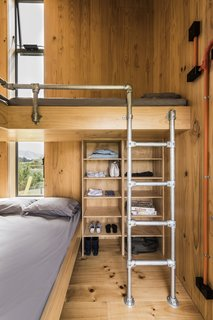 In the second building is a multi-purpose room with a fold-down bed, a kitchenette, and another sleeping area with a bathroom.