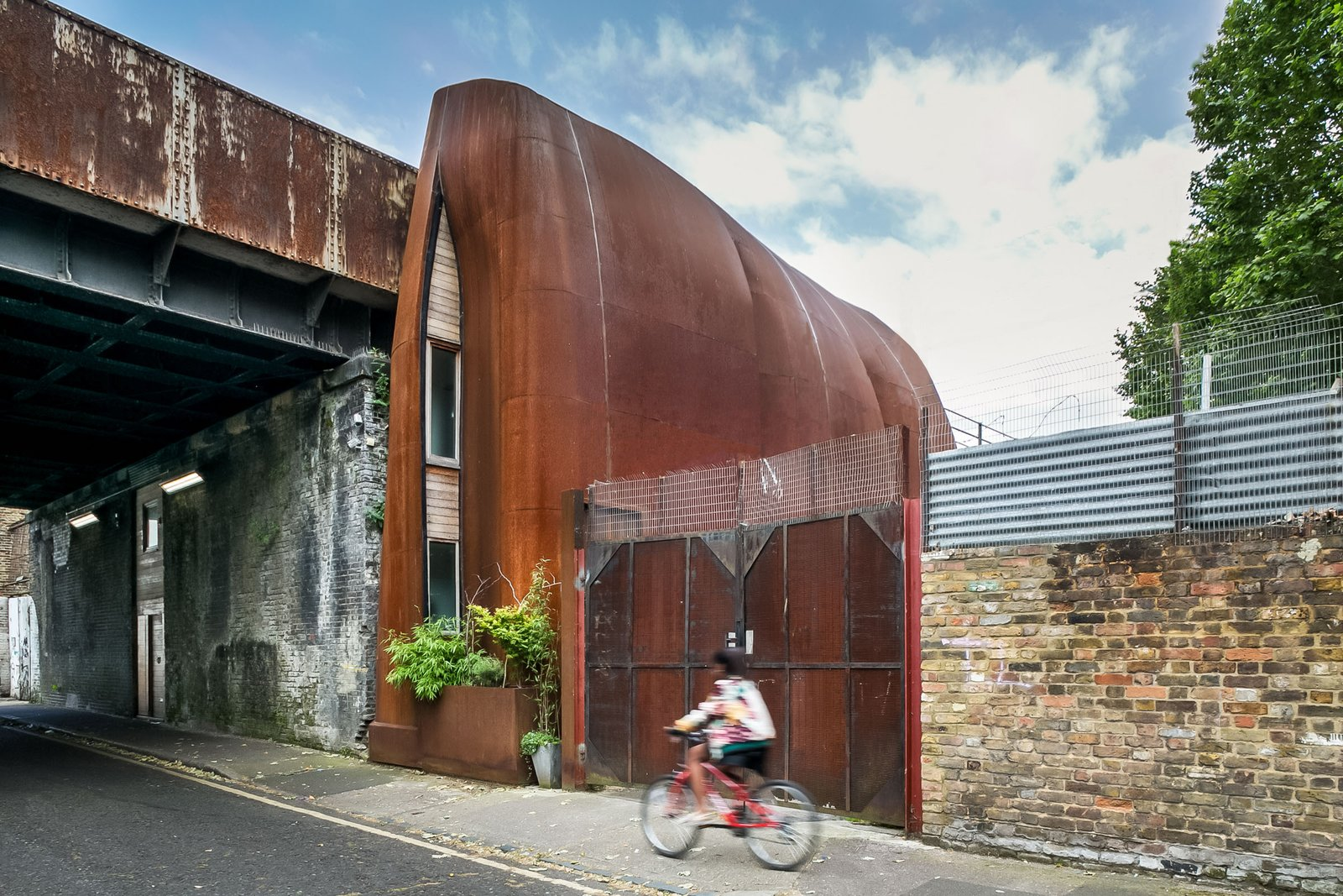 An Astounding Steel Clad Home Under A Railway Viaduct In