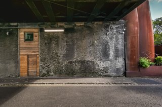 Elevated Victorian viaducts cut through many of London's residential areas, often becoming physical barriers, with derelict, arched corridors at ground level.