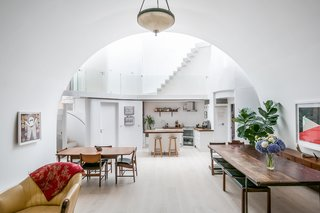 """""""Archway Studios occupies part of a rail viaduct; a vaulted workshop linked to an atrium with residential alcoves,"""" says Undercurrent principal architect, Didier Ryan. """"The design works with the contrast between the compressed, cavernous qualities of the arch—and the slender, ecclesial spaces of the atrium."""""""