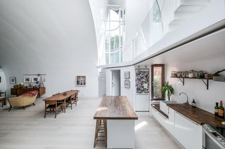 Though the site is narrow with limited sunlight exposure, aspects, and views, these conditions were overcome with the creation of lofty, skylit interiors that free the building from the constraints of its location.