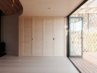 A kitchenette is concealed within a closet.