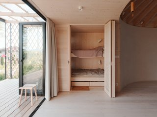 On the opposite side of the kitchen are two bunk beds that can be tucked away.