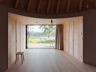 The large, rectangular entrance frames idyllic views of the surrounding countryside.