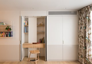 A desk in the girl's bedroom with a chair by Pedro da Costa Felgueiras for The New Craftsmen.