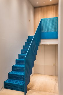 The eye-catching metallic blue staircase was produced by Joe Faller Fabrications.