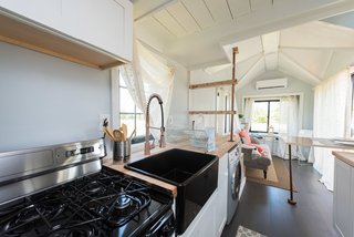 The tiny house comes with a fully equipped kitchen.