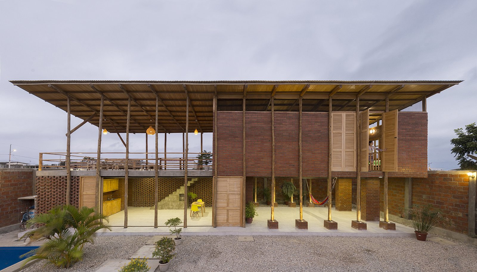 Exterior, Shed RoofLine, Metal Roof Material, House Building Type, Brick Siding Material, Wood Siding Material, and Beach House Building Type  Photo 1 of 16 in Beach Breezes Blow Right Through This Ecuadorian House on Stilts