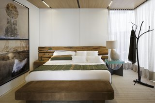 The bedroom features floor-to-ceiling windows with curtains for privacy.