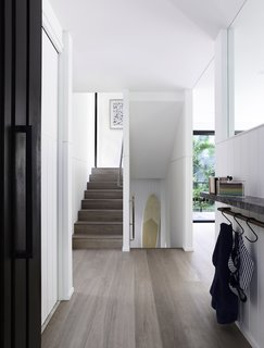 The designers have added a bright, light-filled extension to the 15-year-old house to make it more commodious, as well as to improve the flow of sunlight through the interiors.