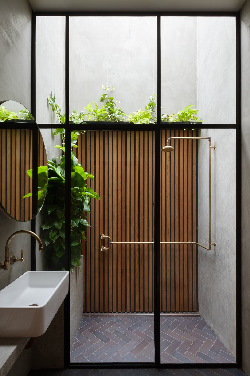 Bath Room, Vessel Sink, Full Shower, Brick Floor, Concrete Counter, and Concrete Wall In the bathroom, the shower stall looks up to the open sky.  Photo 10 of 11 in This Renovated Sydney Home Feels Like a Superhero's Secret Lair