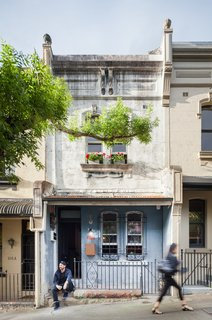 The 1,184-square-foot house is located within a 100-year building. The architects kept much of the existing exterior.