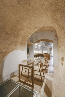 Studio Manca's minimalistic approach highlights the curves and textures of the cave walls and ceilings.