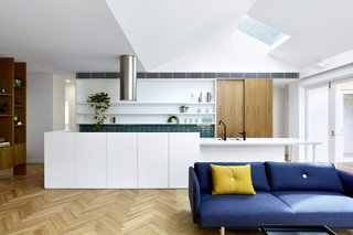 When they took on the renovation of one such home for a family of five, they reconfigured the internal layout to bring more natural light deep into the common living areas, and better connect them to the surrounding landscape.
