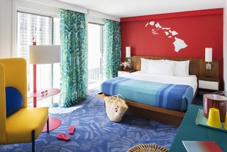"A warm and cheerful ""Aloha"" comes through in the tropical leaf motifs of the carpet and curtains."