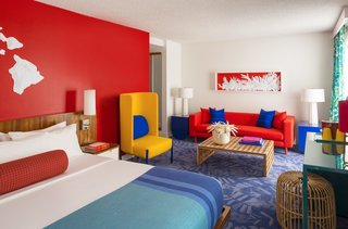 Each guest room follows a color scheme of contrasting primary colors.