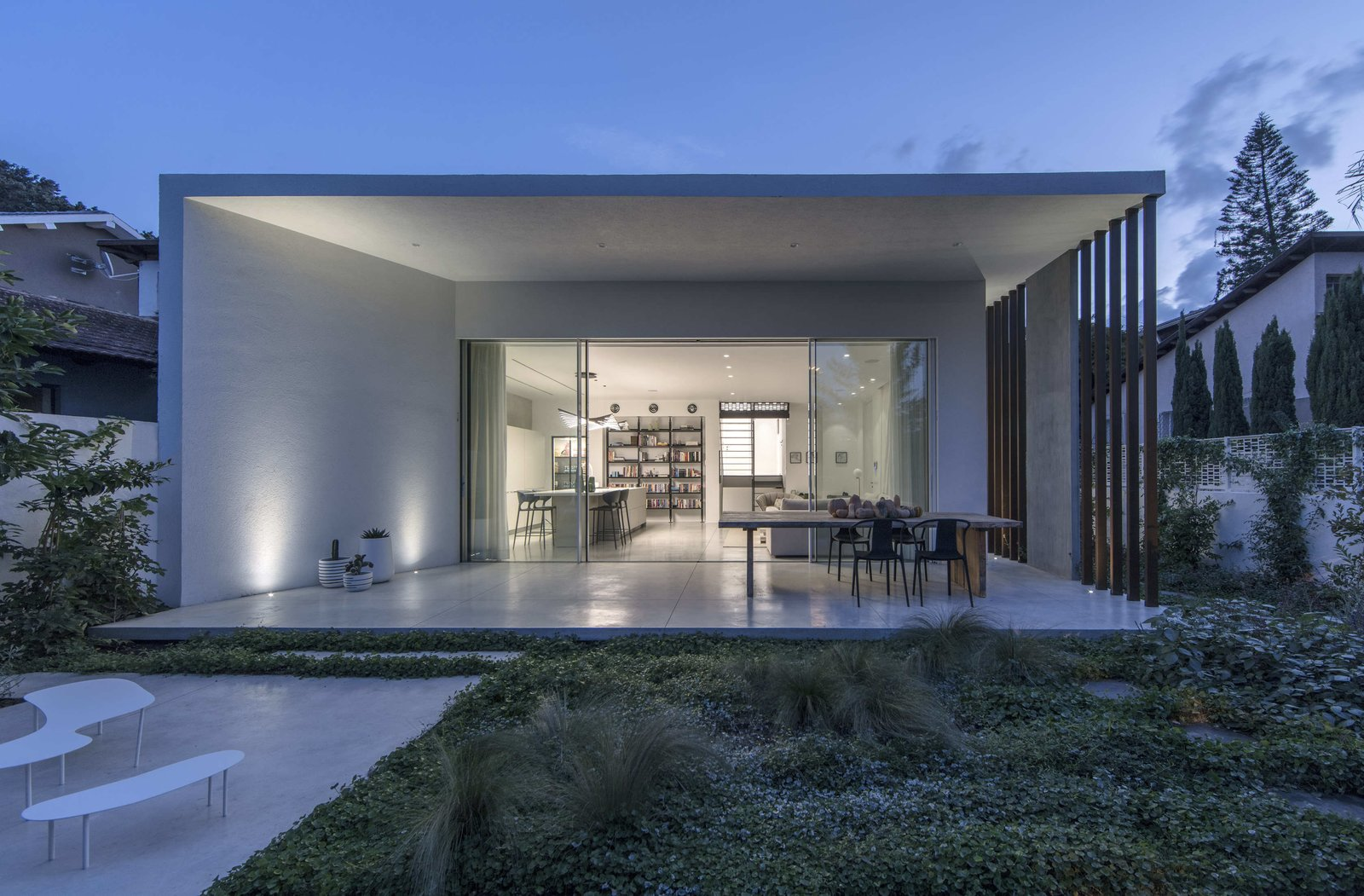 Outdoor, Back Yard, Shrubs, Grass, Large Patio, Porch, Deck, and Horizontal Fences, Wall  Photo 1 of 19 in Sleek Concrete Cubes Form This Pavilion-Like Home in Israel