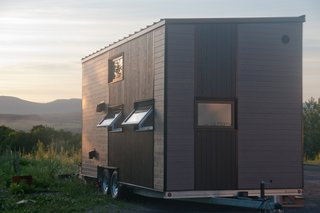 Though it's just 190 square feet, this tiny house, which has plenty of wooden details and modern-rustic charm, is a home and office for its owner.