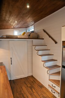 The complex design includes a room under the loft that has an ensuite bathroom.