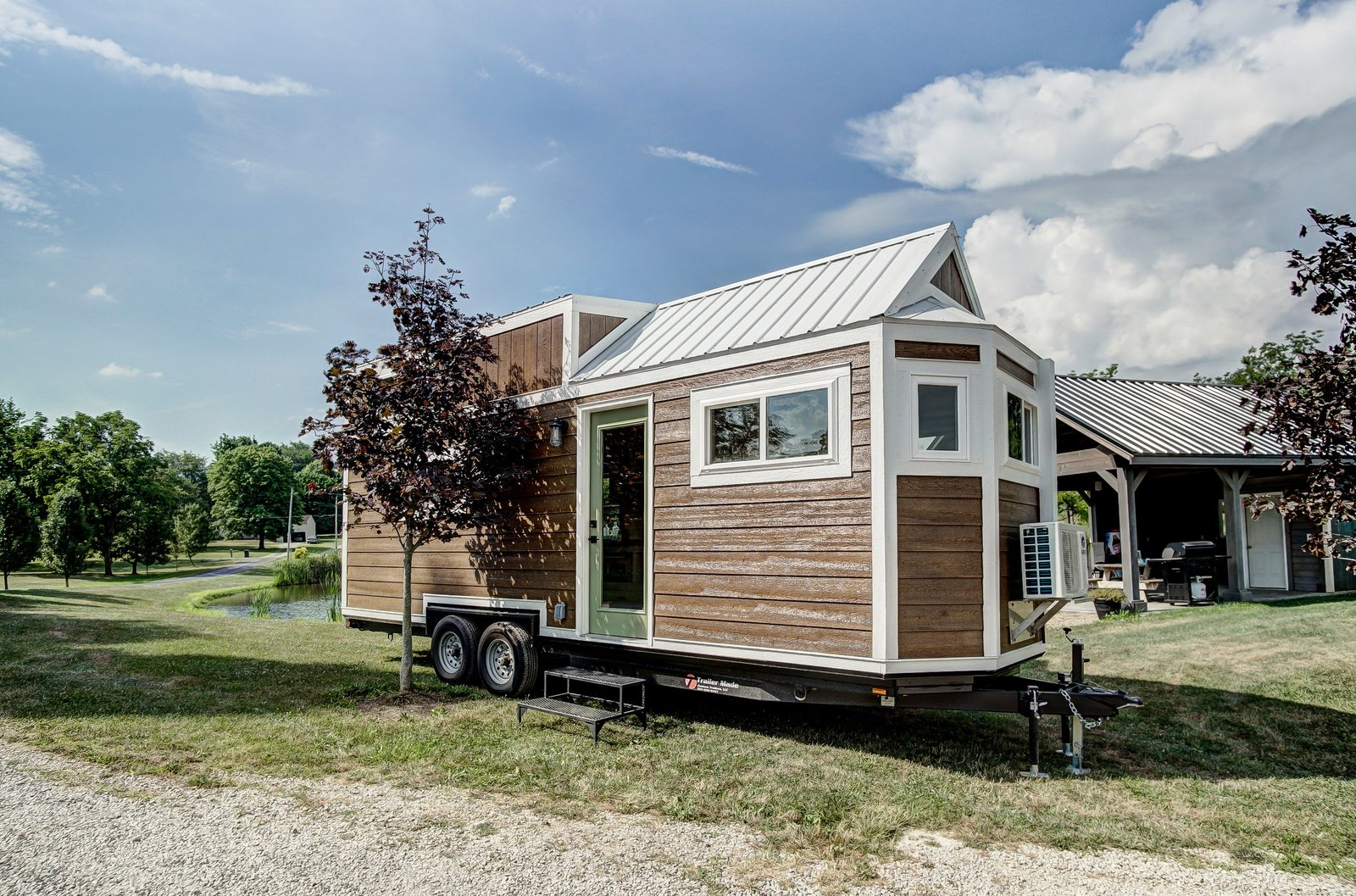 Exterior, Flat RoofLine, Tiny Home Building Type, Wood Siding Material, and Gable RoofLine  Photo 1 of 11 in This 270-Square-Foot Tiny Home Is Now Up For Grabs at $89K