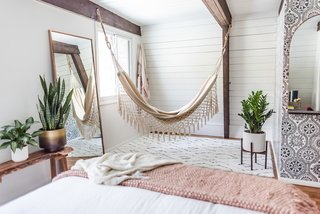 A hammock swings in one of the bedrooms.