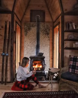 Sara Underwood relaxes by the fireplace in Witzling's fifth cabin.