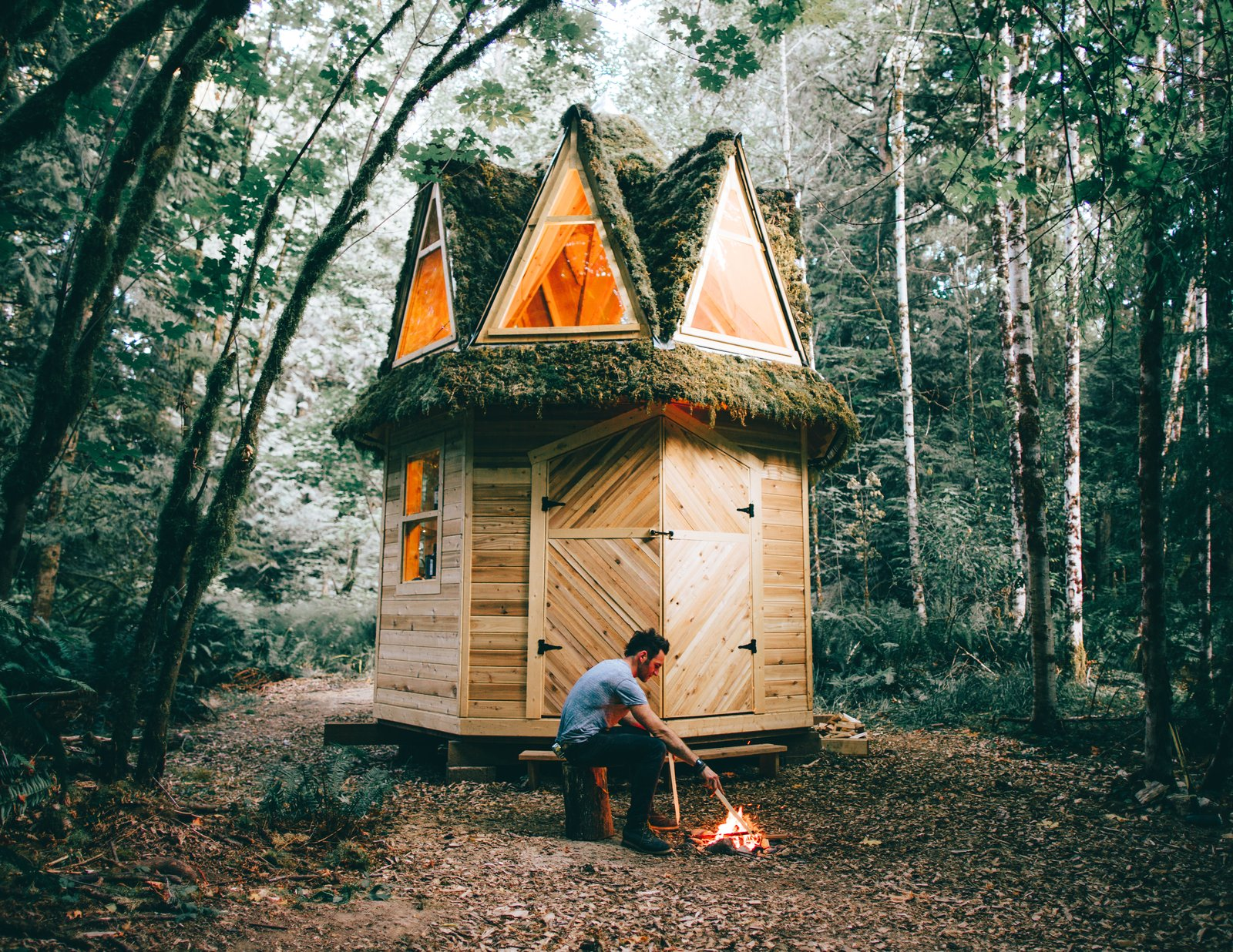 """""""I used the same roofing concept on this cabin as I did with the second, covering it in metal, chicken wire and moss,"""" says Witzling."""