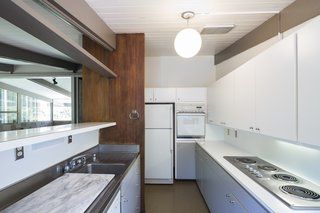 A streamlined, white kitchen.