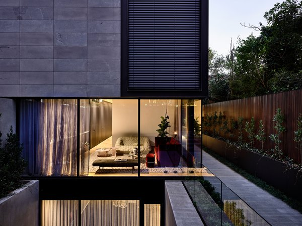 Exterior, Flat RoofLine, and House Building Type Part of the house is embedded under the lush, landscaped garden.  Photo 4 of 20 in A Strong Builder Bond Results in a Sophisticated Australian Home
