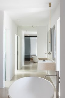 A free-standing bathtub is located in one of the two bathrooms.