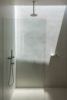 The two bathrooms are sited on either end of the rectangular plan. Each have been fitted with discrete skylights for additional illumination.