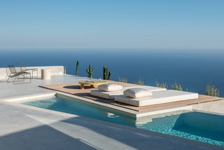 The house is oriented toward the Aegean Sea. Floor-to-ceiling, glass sliding doors flood the home with plenty of Mediterranean sunshine.